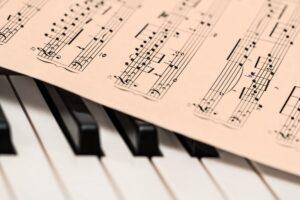 Piano with score sheet