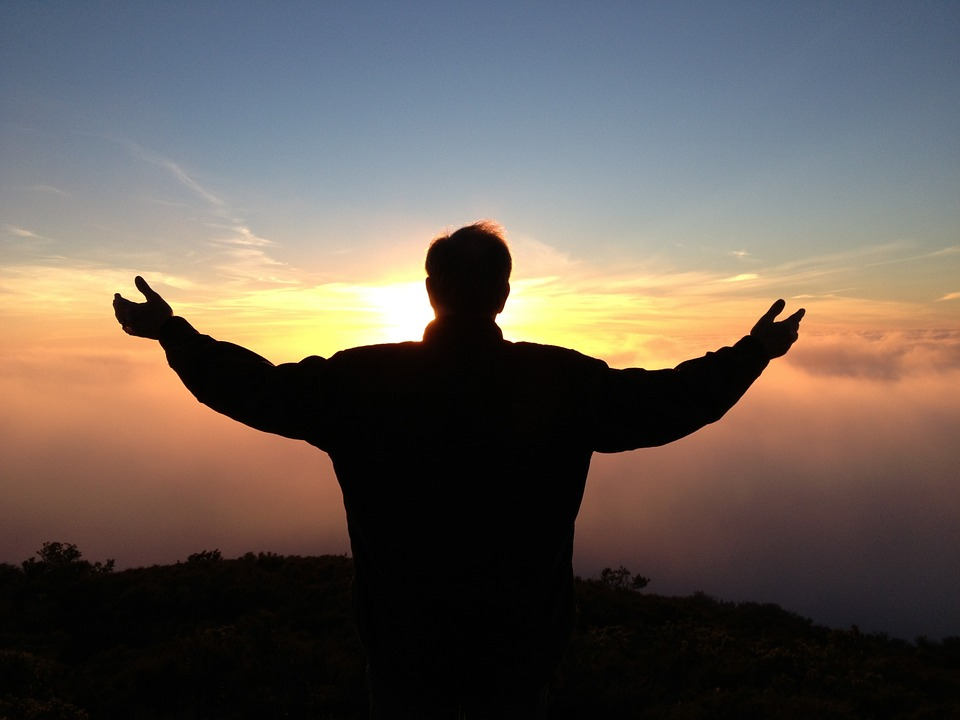 Power of prayer- man praying with outstretched arms