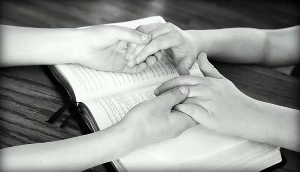 hands held together to pray