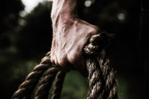 Prayers for strength - hand gripping a rope