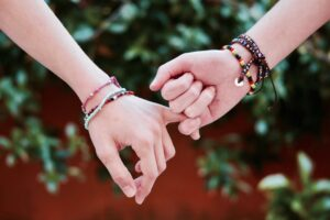 bible verses about friendship - two hands holding