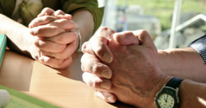pray for one another - hands to pray
