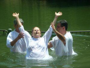 Baptism through water, woman baptized
