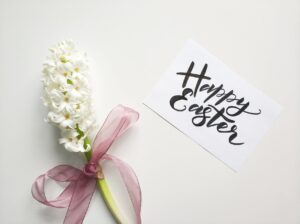 Easter colors- white flower with happy easter greetings