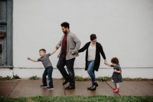 bible verses about family - a family walking hand on hand