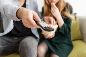 man holding a remote control