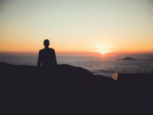 Bible verses about hope - man standing over a horizon