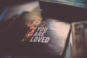 you are loved text on paper