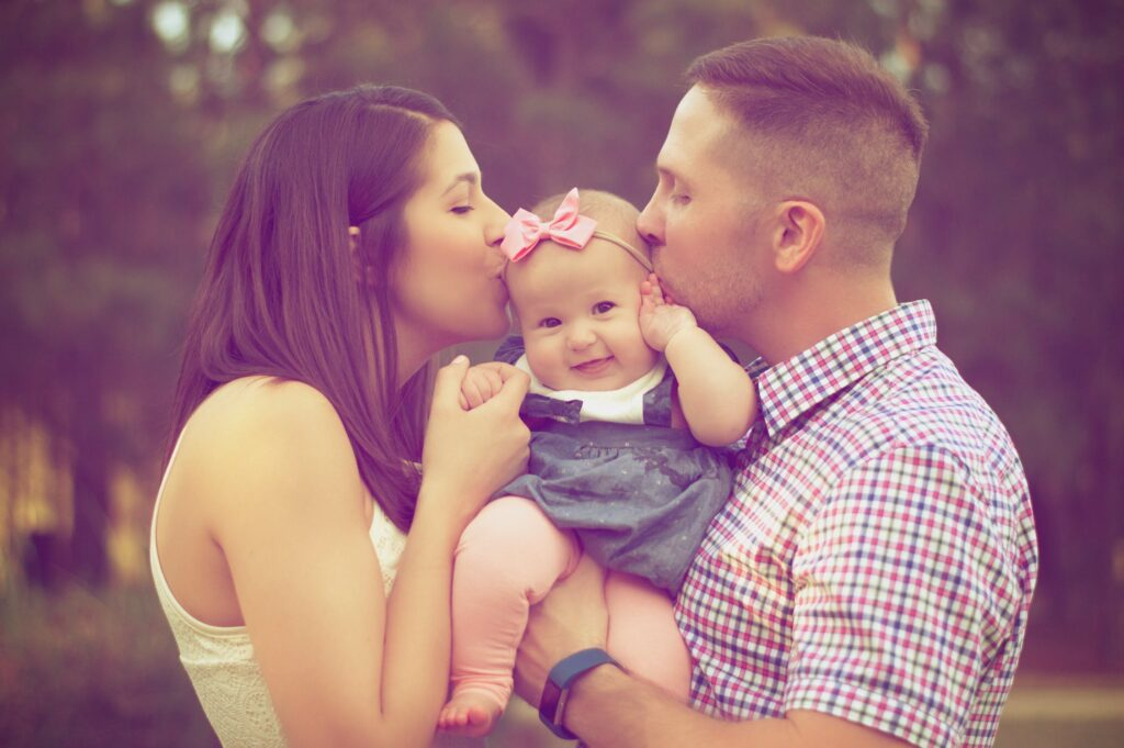 bible verses about family - mother and father kisses their daughter