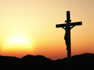 silhouette of Christ on the cross