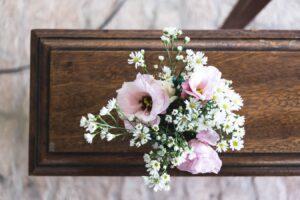 Bible verses for funerals - casket with flower