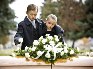 Bible verses for funerals - girl and boy before a casket