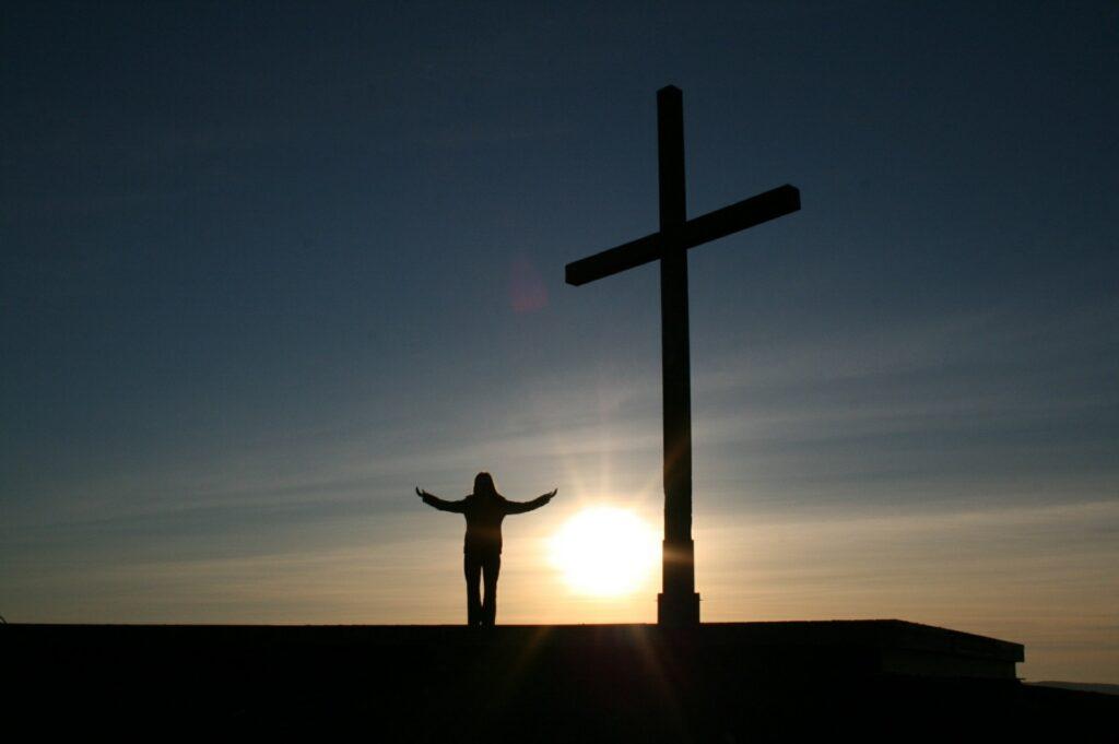 Cross, Praying