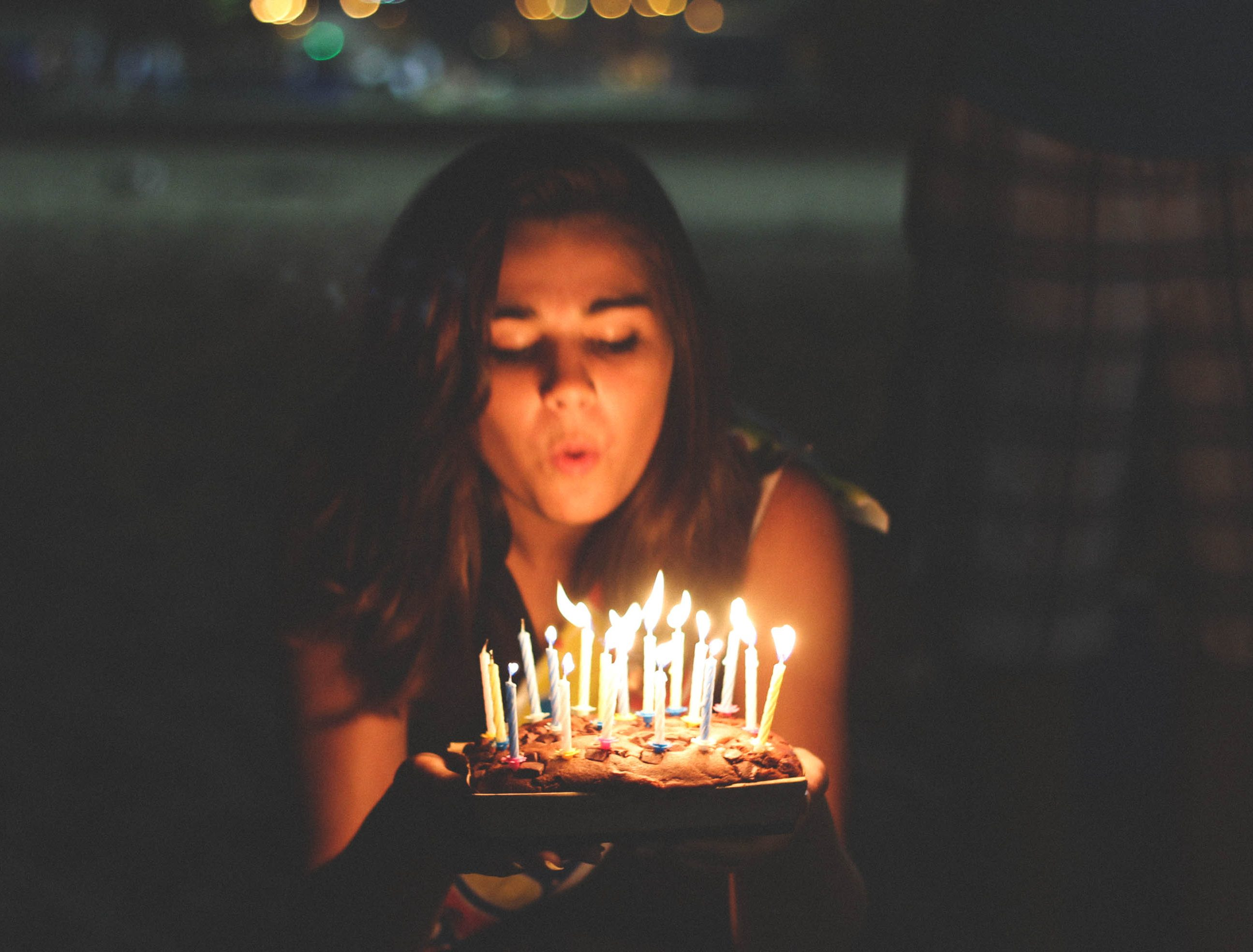 Girl blowing her birthday cake