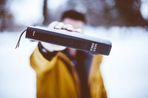 Christian values - man holding a bible