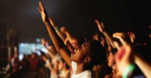 crowd worshiping God