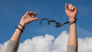 hands being free from handcuffs