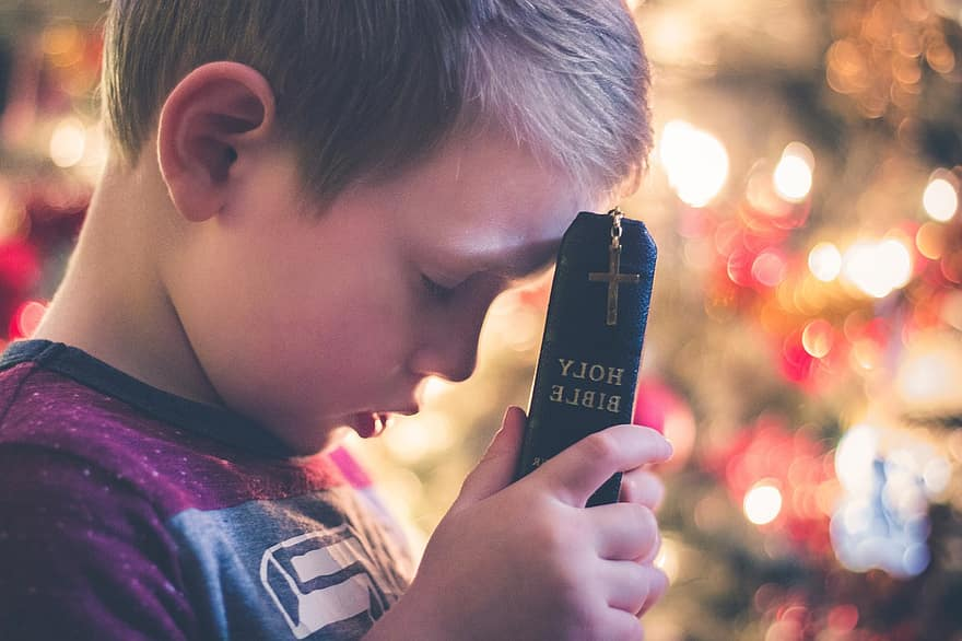 young boy holding a Bible