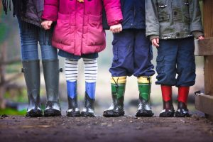 four children wearing boots
