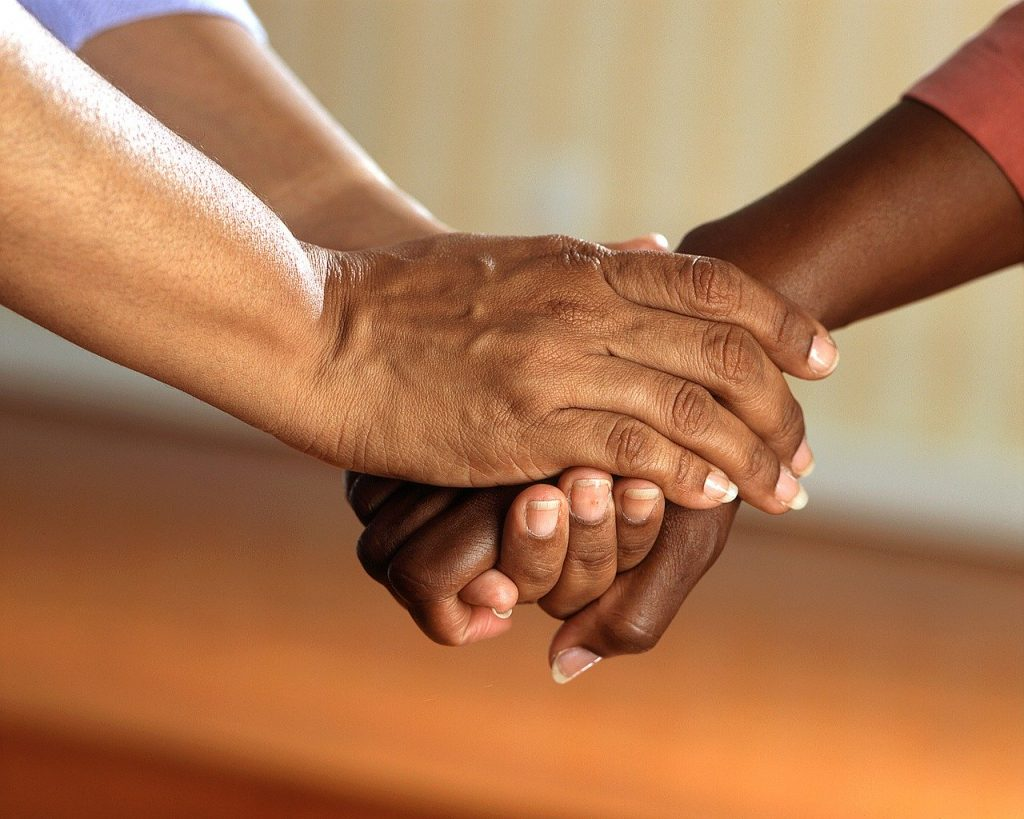 Helping Others, Clasped Hands