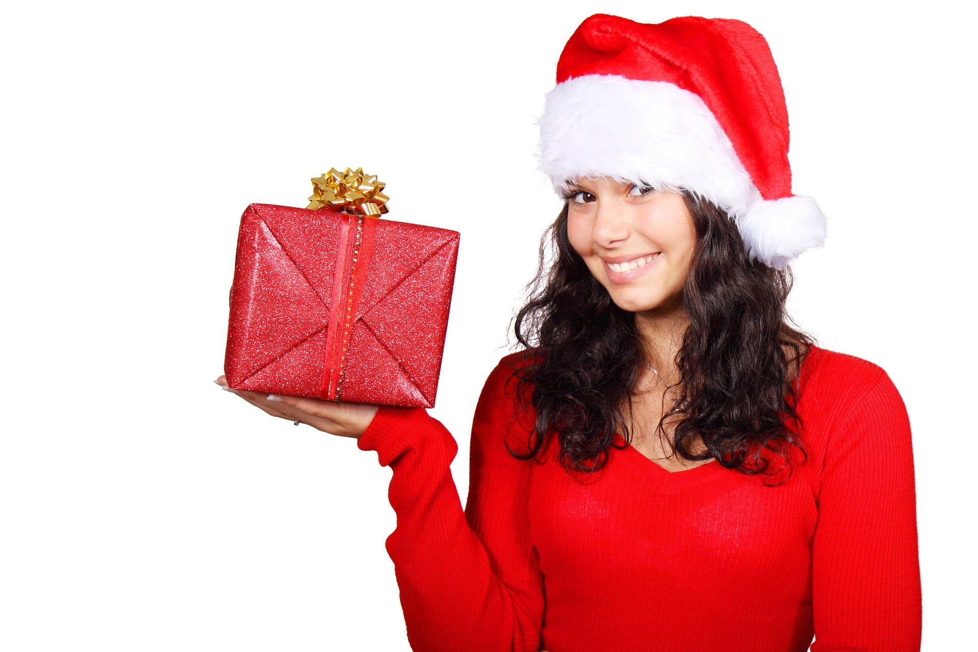 Girl holding a gift, santa outfit