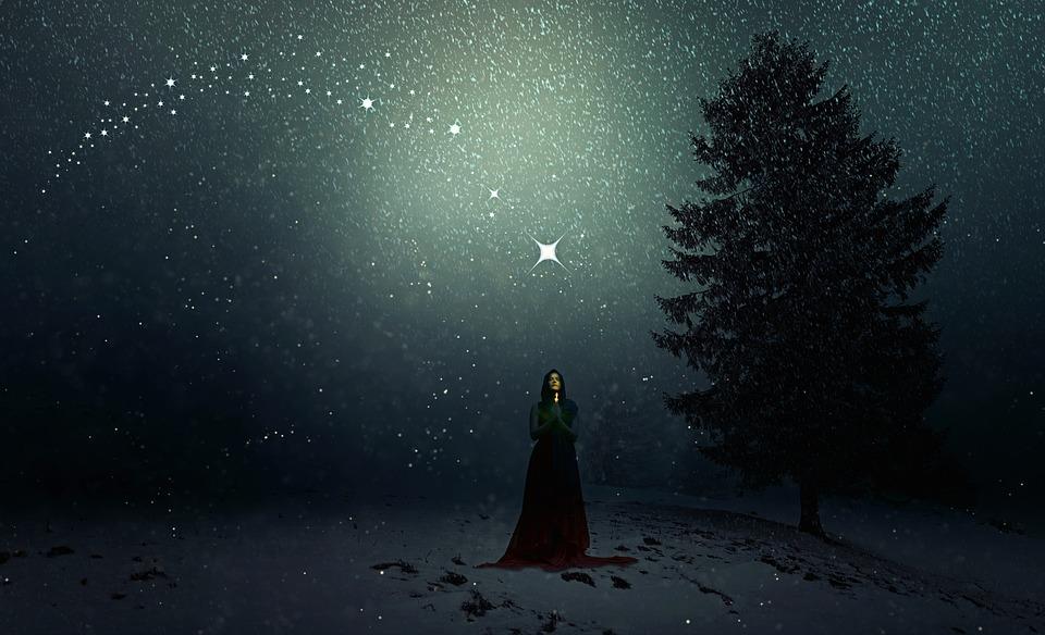starry night, woman praying under the stars